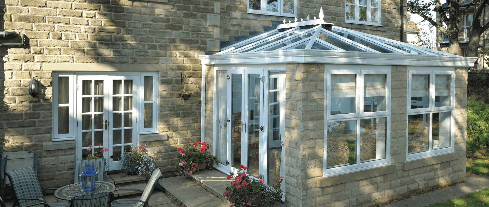 Modern Edwardian conservatory with brick walls and French doors